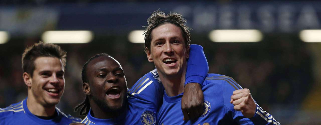 Chelsea's Fernando Torres (R) celebrates his goal against Aston Villa with teammates Victor Moses (C) and Cesar Azpilicueta.