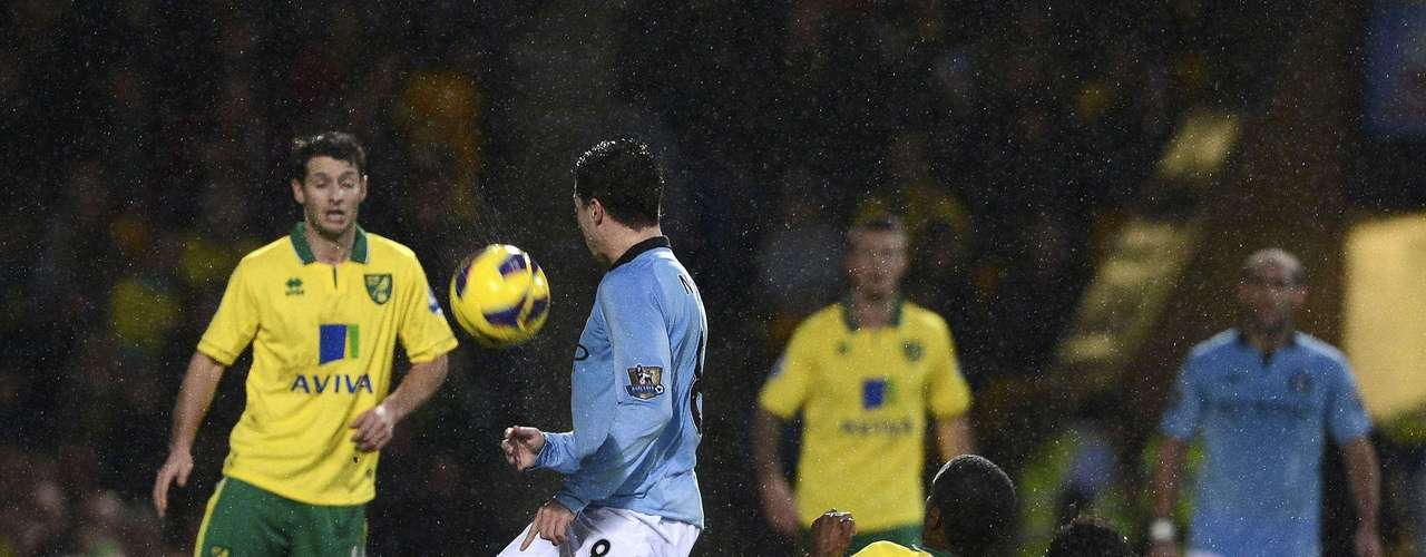 Bassong (2nd R) fouls Nasri. Bassong was shown the yellow card for the tackle and Nasri was sent off following the clash. REUTERS/Dylan Martinez