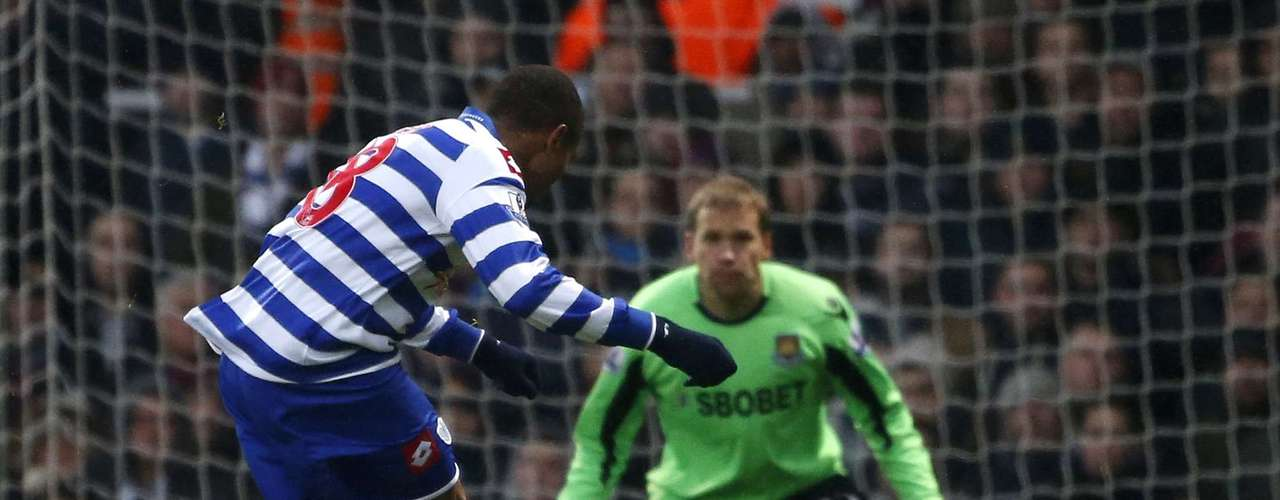 Queens Park Rangers' Loic Remy (L) shoots and scores his goal past West Ham United goalkeeper Jussi Jaaskelainen.