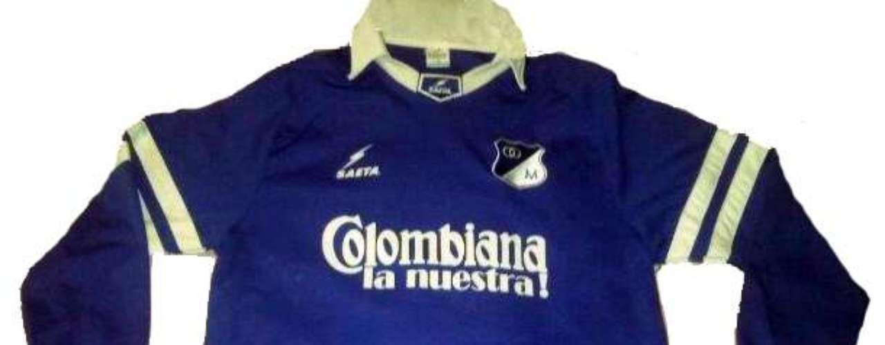 Camiseta manga larga utilizada por Millonarios marca Saeta y patrocinada por Colombiana, similar a la que utilizó para conseguir su último título en la década del ochenta