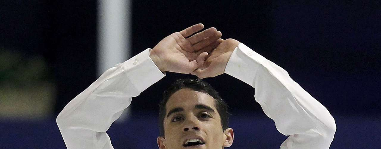 Javier Fernandez of Spain acknowledges the crowd after his performance during the men's free skating program at the European Figure Skating Championships in Zagreb January 26, 2013.                  REUTERS/Antonio Bronic (CROATIA  - Tags: SPORT FIGURE SKATING)