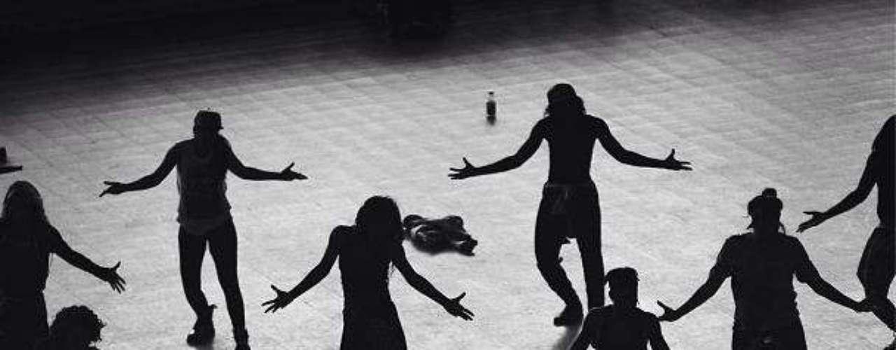 The crew practices Sunday night's choreography.