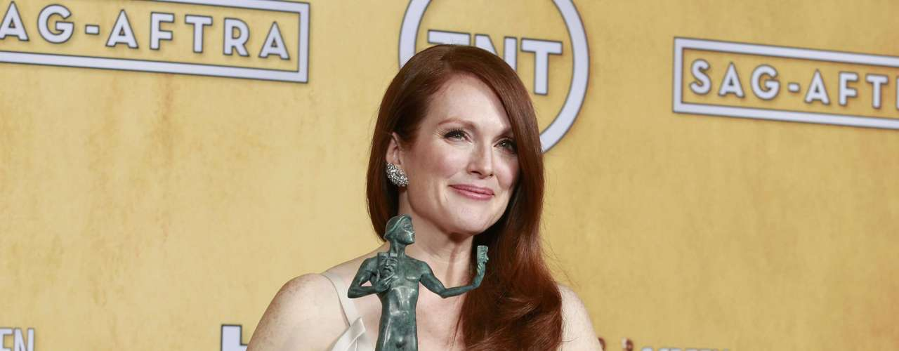 Julianne Moore holds her award for outstanding female actor in a TV movie or miniseries for \