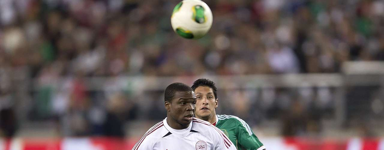 Reyna chases Jores Okore off the ball.