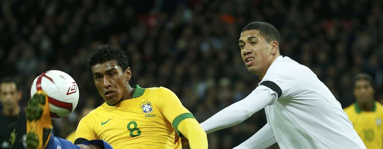 England's Chris Smalling challenges Brazil's Paulinho (L) during their international friendly soccer match.