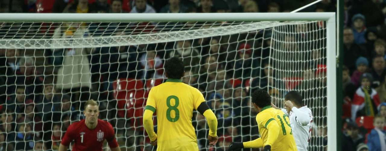 Brazil's Fred (2nd R) scores the equaliser past England's goalkeeper Joe Hart (L) during their international friendly soccer match.