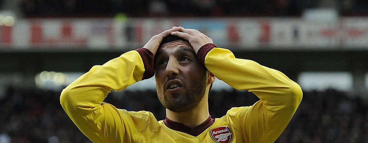 Arsenal's Santi Carzola reacts during after missing a chance.