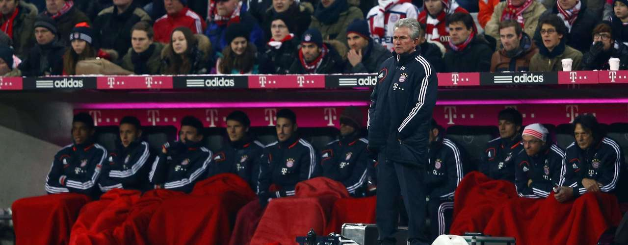 Bayern Munich's coach Jupp Heynckes watches the game.