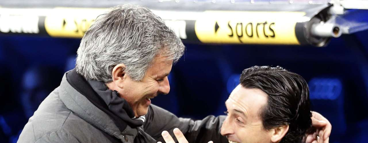 Real Madrid's coach Jose Mourinho (L) greets Sevilla's coach Unai Emery before the match.
