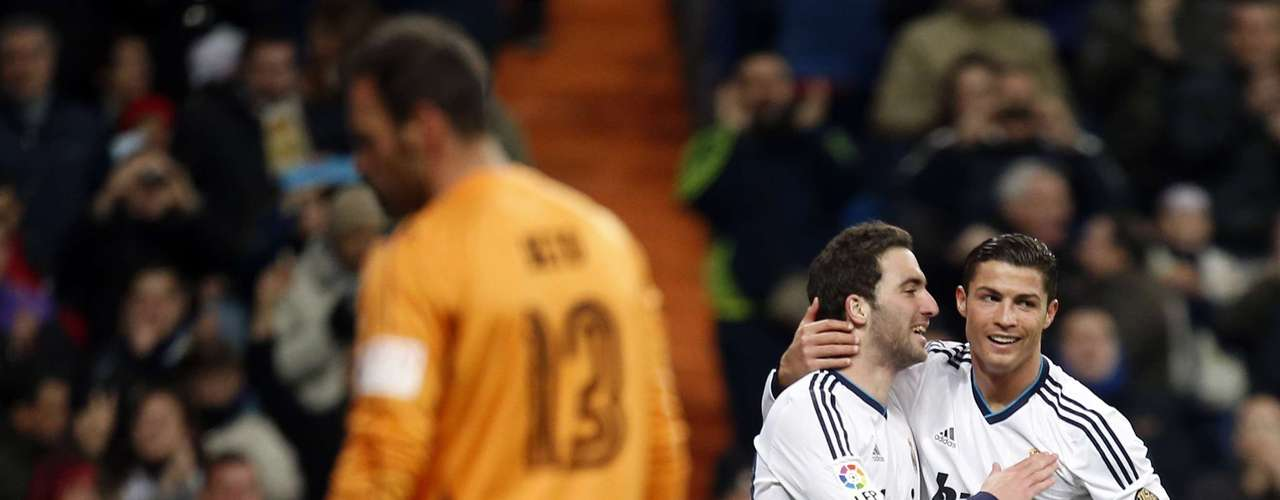 Cristiano Ronaldo (R) is congratulated by his teammate Gonzalo Higuain after scoring his third goal.