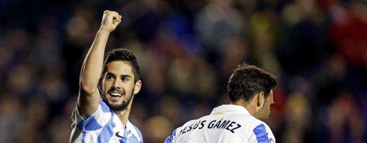 Isco celebrates after scoring on a penalty kick.