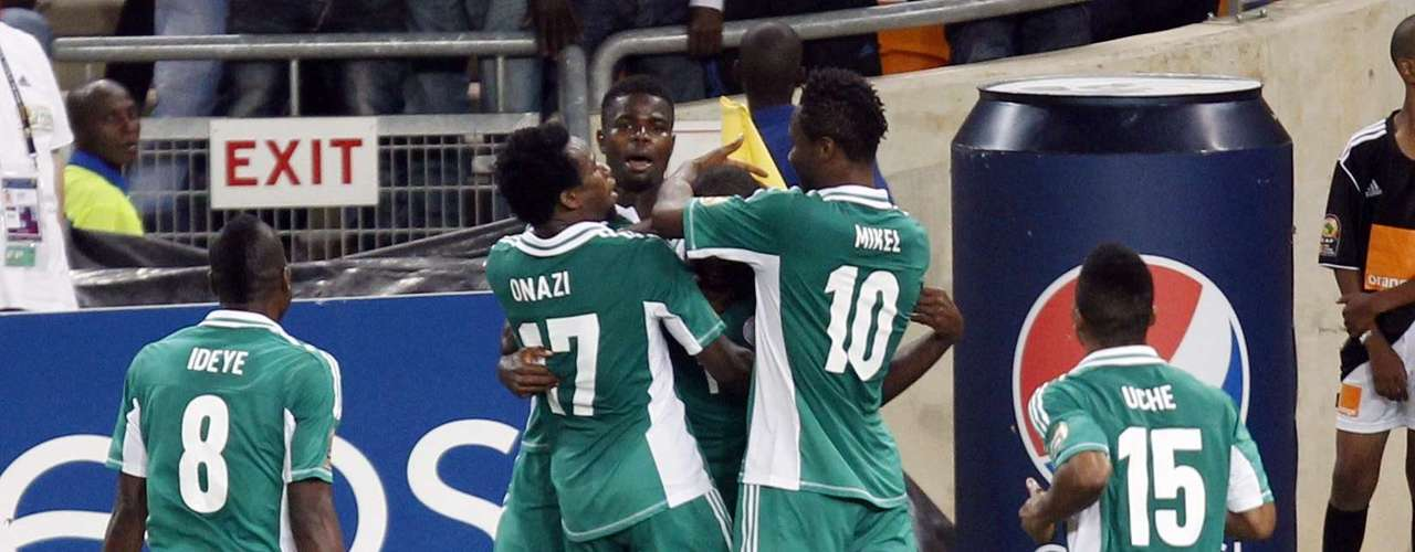 Nigeria's players celebrate after scoring against Burkina Faso during their African Nations Cup (AFCON 2013) final soccer match in Johannesburg.