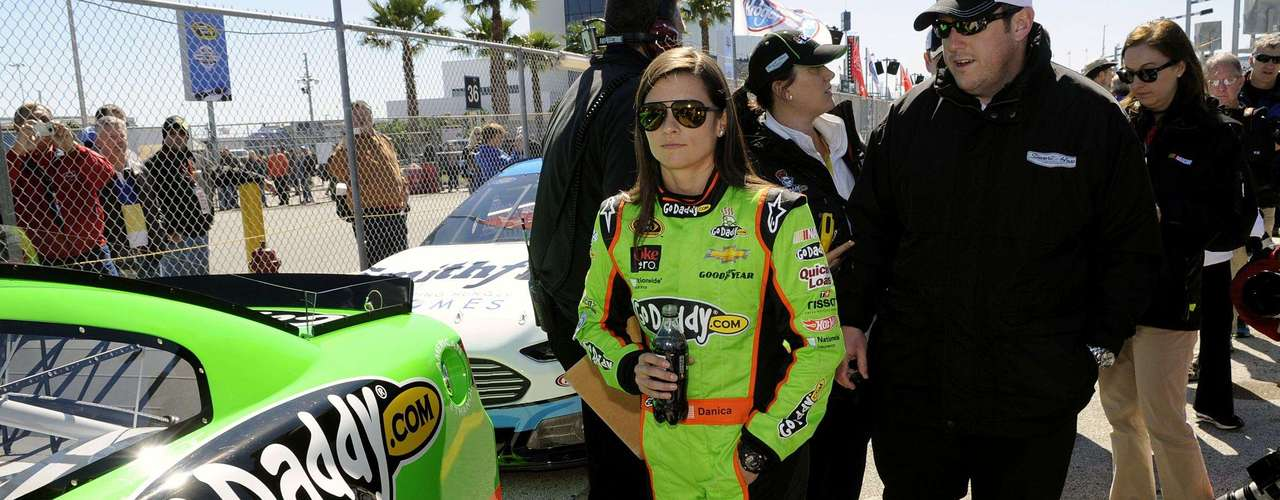 NASCAR Sprint Cup Series driver Danica Patrick, of the number 10 car, walks away from her vehicle after her Daytona 500 pole position-securing run during qualifying for the Daytona 500, at Daytona International Speedway in Daytona Beach, Florida, February 17, 2013.