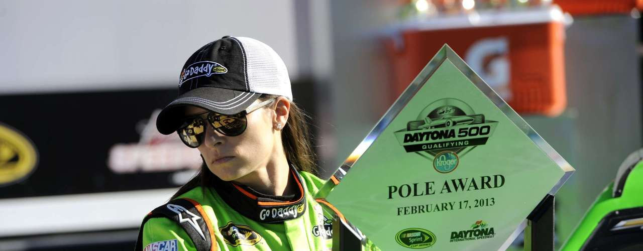 NASCAR Sprint Cup Series driver Danica Patrick, of the number 10 car, picks up her trophy in victory lane as she celebrates securing the pole position for the upcoming Daytona 500, during qualifying for the Daytona 500, at Daytona International Speedway in Daytona Beach, Florida, February 17, 2013.