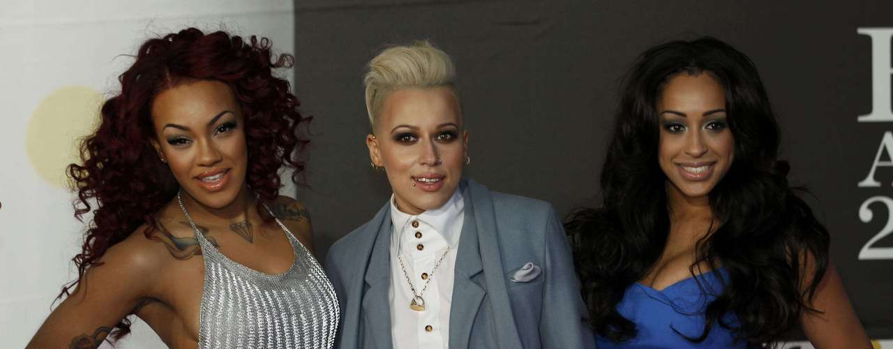 Pop group Stooshe arrive for the BRIT Awards, celebrating British pop music, at the O2 Arena in London February 20, 2013. REUTERS/Luke Macgregor (BRITAIN  - Tags: ENTERTAINMENT)