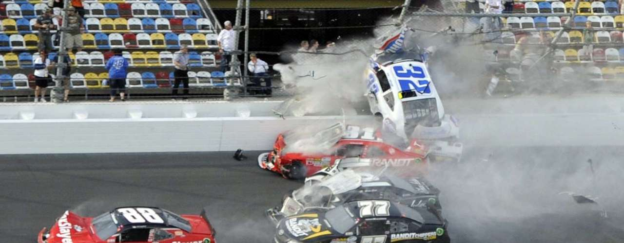 Larson (32) and his Chevrolet end up in the fence during the final lap crash. REUTERS/Brian Blanco