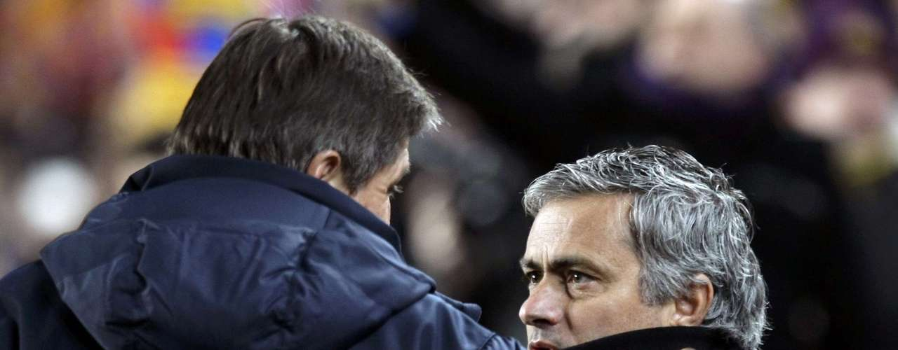 Real Madrid's coach Jose Mourinho (R) talks to Barcelona's assistant coach Jordi Roura before their Spanish King's Cup semifinal.