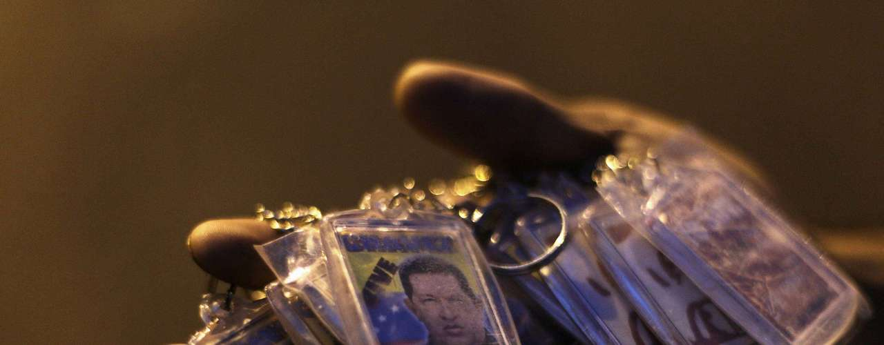 A street vendor offers keychains with the picture of the late Venezuelan President Hugo Chavez with the word \