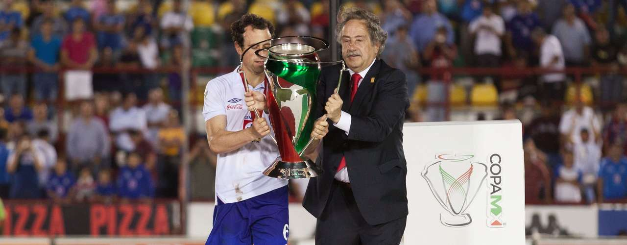 Gerardo Torrado holds the COPA MX title after the game.
