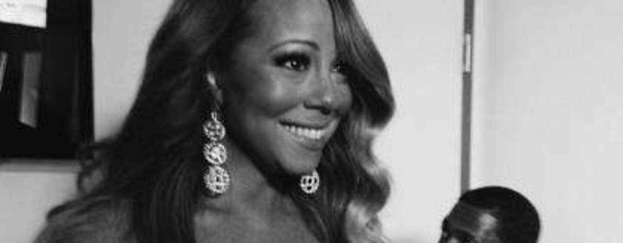 1 de Julio -Mariah Carey con su inseparable Nick Cannon esperando la hora en que la diva se presentara en el escenario con ese vestidito que nos dejó con la boca abierta