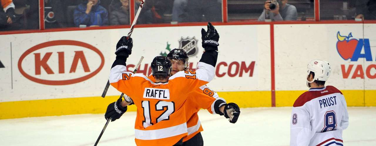 Dec 12, 2013; Philadelphia, PA, USA; Philadelphia Flyers left wing Michael Raffl (12) celebrates his goal with right wing Jakub Voracek (93) against the Montreal Canadiens during the first period at Wells Fargo Center. Mandatory Credit: Eric Hartline-USA TODAY Sports