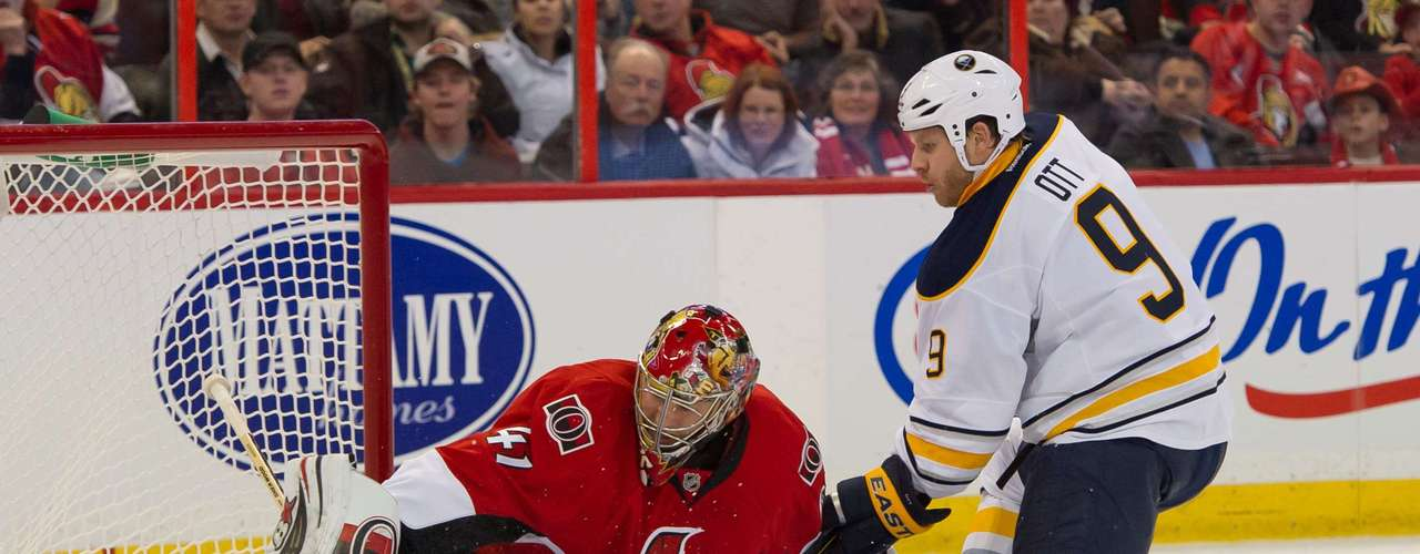 Dec 12, 2013; Ottawa, Ontario, CAN; Buffalo Sabres center Steve Ott (9) shoots on Ottawa Senators goalie Craig Anderson (41) in the first period at the Canadian Tire Centre. Mandatory Credit: Marc DesRosiers-USA TODAY Sports