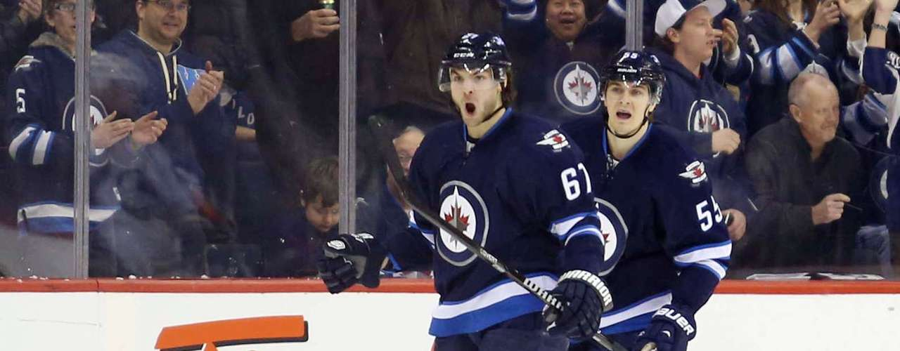 Dec 12, 2013; Winnipeg, Manitoba, CAN; Winnipeg Jets forward Michael Frolik (67) celebrates scoring against the Colorado Avalanche during the first period at the MTS Center. Mandatory Credit: Bruce Fedyck-USA TODAY Sports