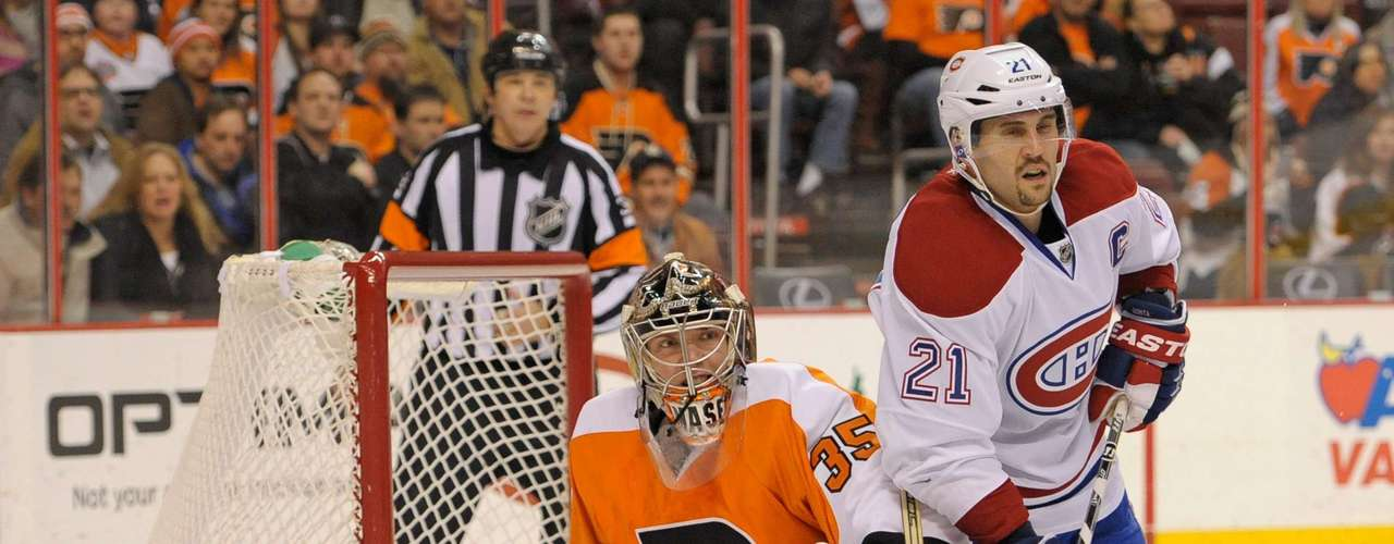 Dec 12, 2013; Philadelphia, PA, USA; Philadelphia Flyers goalie Steve Mason (35) and Montreal Canadiens right wing Brian Gionta (21) at the end of the third period. The Flyers won 2-1. Mandatory Credit: Eric Hartline-USA TODAY Sports