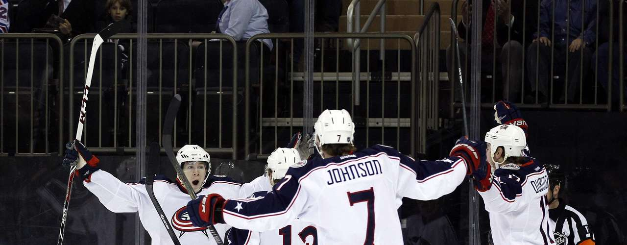 Dec 12, 2013; New York, NY, USA; Columbus Blue Jackets left wing Matt Calvert (11) celebrates scoring a goal against the New York Rangers during the first period at Madison Square Garden. The Columbus Blue Jackets defeated the New York Rangers 4-2. Mandatory Credit: Adam Hunger-USA TODAY Sports