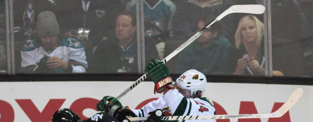 Dec 12, 2013; San Jose, CA, USA; San Jose Sharks center Joe Pavelski (8) and Minnesota Wild left wing Matt Cooke (24) collide during the first period at SAP Center at San Jose. Mandatory Credit: Ed Szczepanski-USA TODAY Sports