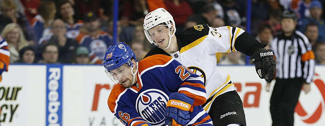 Dec 12, 2013; Edmonton, Alberta, CAN;Edmonton Oilers forward Mark Arcobello (26) carries the puck up the ice against the Boston Bruins during the third period at Rexall Place. Mandatory Credit: Perry Nelson-USA TODAY Sports