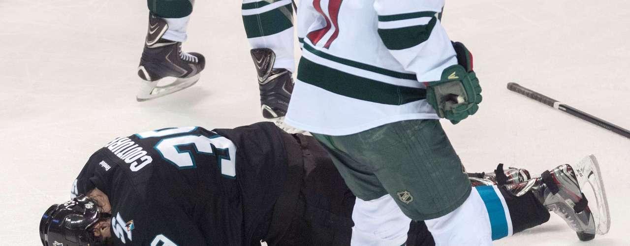 Dec 12, 2013; San Jose, CA, USA; San Jose Sharks center Logan Couture (39) reacts to an injury during the third period of the game aMinnesota Wild at SAP Center at San Jose. The San Jose Sharks defeated the Minnesota Wild 3-1. Mandatory Credit: Ed Szczepanski-USA TODAY Sports