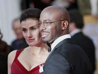 Actors Idina Menzel and Taye Diggs arrive at the 19