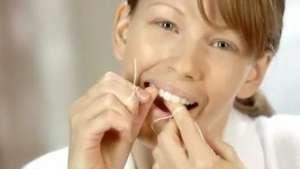 Como usar o fio dental Video:
