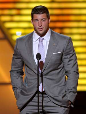 Tim Tebow says he wouldn't rule out running for office when his NFL career ends. Foto: AP in English