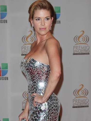 Alicia Machado's bodacious curves killed on the red carpet.