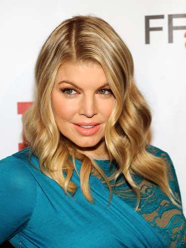 Fergie Ferg was sexy in a blue sash dress at an event honoring Stuart Weitzman.