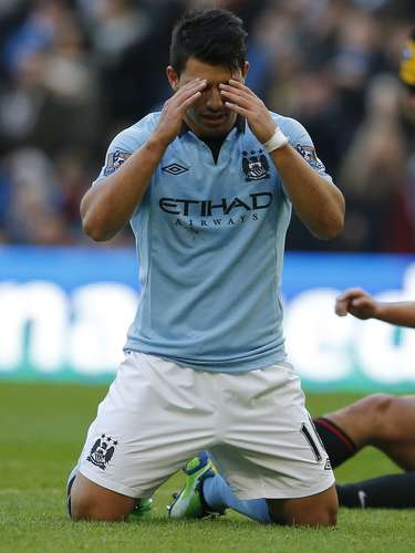 Manchester City's Sergio Aguero reacts after missing a chance to score.