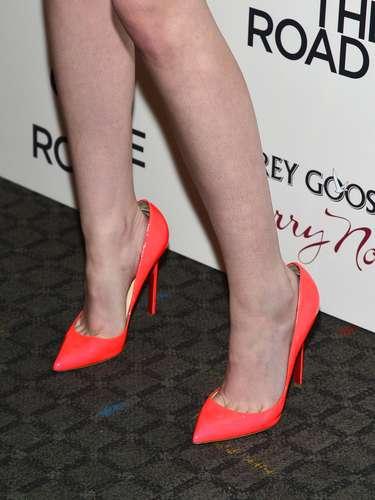 To match her sparkling beaded dress, Kristen wore bright orange heels.