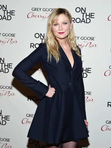 Meanwhile,Kirsten Dunst kept it chic in a navy blue ensemble.