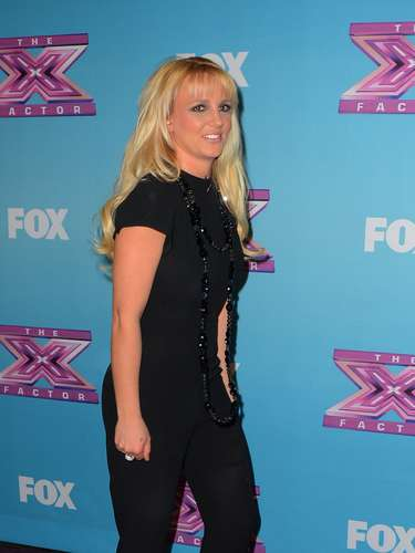 Britney Spears is this year's highest-paid female in music thanks to the career-boosting stint as a judge on 'The X-Factor. Check out the singer celebrate a heck of year, looking good but tired at 'The X Factor' Season Finale Night 1 on December 19 in Los Angeles.