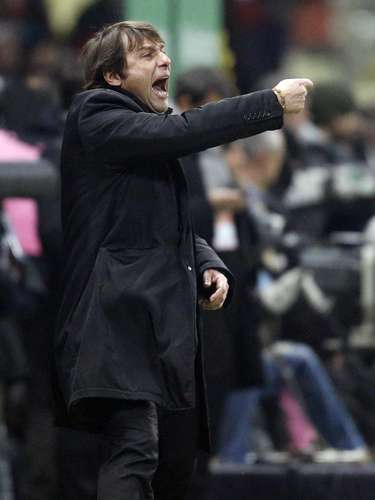 Juventus' coach Antonio Conte reacts during his team's Serie A game in Parma.