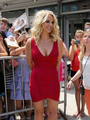 Britney also wore a tight red dress showing off her biggest assets.