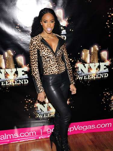 Kelly Rowland mixed leather and animal print. Was she doing an homage to Peggy Bundy from \