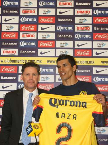 'Maza' poses with his jersey alongside Ricardo Pelaez. Maza will use the number two.