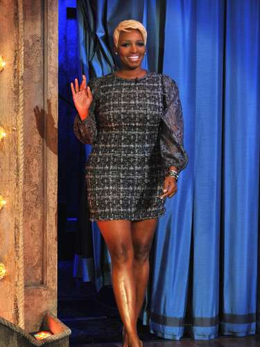 The revealing dress showed off her big thick legs which NeNe had no problem in flaunting.