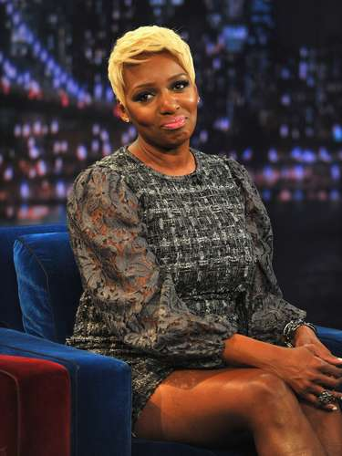 NeNe's head was glowing with her signature bleached blonde hair.
