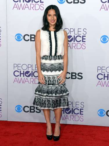 WORST: Olivia Munn, star of The Newsroom, left much to be desired with her outfit. Where's the color? Where's the umph? Did she save it all to use it up to present an award to Taylor Swift?