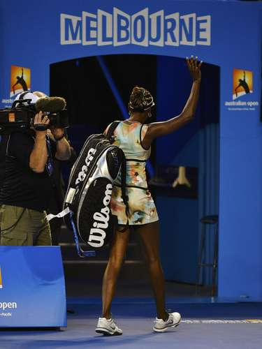 Venus leaves after being defeated by Sharapova. REUTERS/Toby Melville
