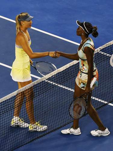 Sharapova of Russia (L) shakes hands with Williamsafter defeating her in straight sets 6-1, 6-3. REUTERS/Tim Wimborne